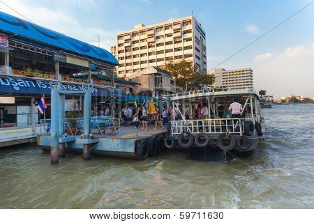 BANGKOK, THAILAND - JANUARY 10, 2012: Tourists leaving the Khlong Saen Saep water bus. It serves over 50,000 passengers daily.