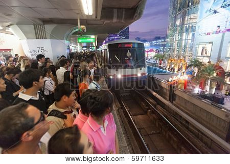 BANGKOK, THAILAND - JANUARY 10, 2012: People at crowded BTS Skytrain waiting for train. 600,000 passengers ride the Skytrain daily.