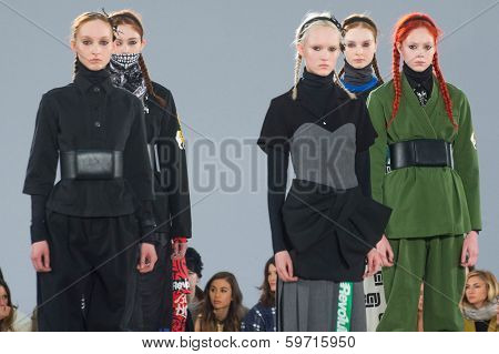 NEW YORK-FEB 13: Models pose on the runway at the Marc Jacobs fashion show during Mercedes-Benz Fashion Week Fall 2014 at Lexington Avenue Armory on February 13, 2014 in New York City.