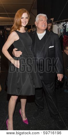 NEW YORK-FEB 10: Actress Sarah Rafferty and Dennis Basso pose backstage before the Dennis Basso fashion show during Mercedes-Benz Fashion Week at Lincoln Center on February 10, 2014 in New York City.