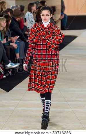 NEW YORK-FEB 13: A model walks the runway at the Marc Jacobs fashion show during Mercedes-Benz Fashion Week Fall 2014 at Lexington Avenue Armory on February 13, 2014 in New York City.