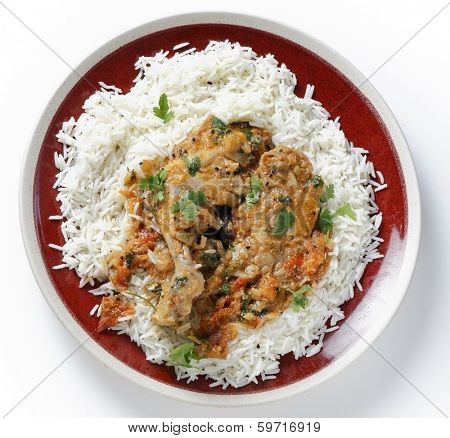 Basic homemade balti chicken on a bed of white basmati rice, seen from above