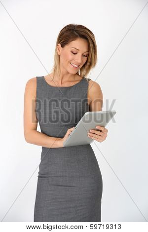 Cheerful businesswoman using digital tablet, isolated