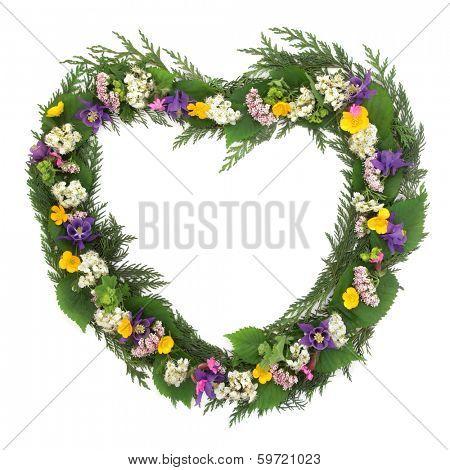 Wild flower heart shaped wreath over white background.
