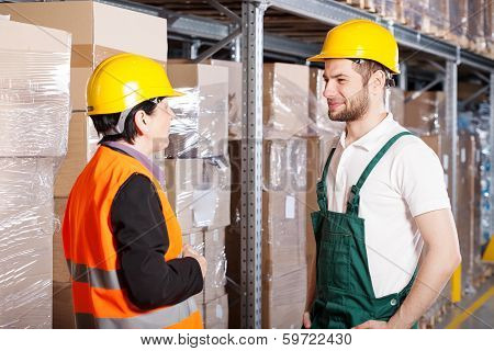 Manager Talking With Worker