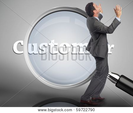 Businessman posing with arms raised against magnifying glass showing customer word in white