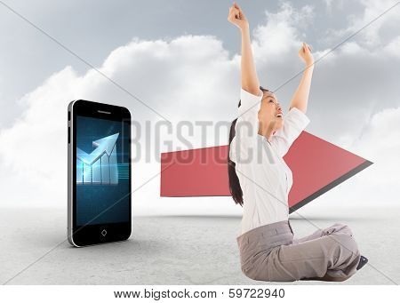 Businesswoman sitting cross legged cheering against red arrow in the sky