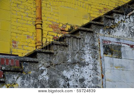Yellow brick and concrete steps