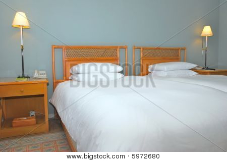 Twin Beds In Modern Hotel Room
