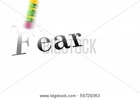 Person using a pencil eraser to erase fear from their life so they can start new