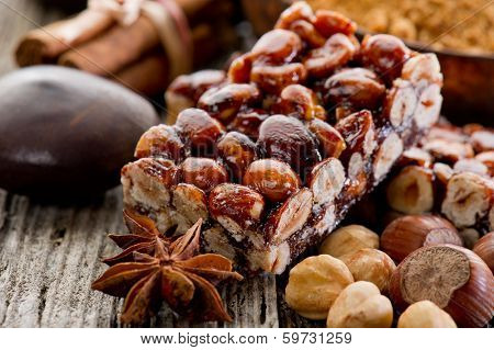 hazelnut brittle on wood with ingredients