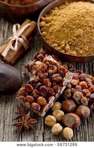 hazelnut brittle on wood with ingredients