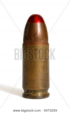 Single standing red-tipped tracer 9mm Parabellum cartridge isolated