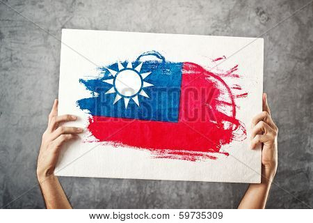 Holding Banner With Taiwan Flag.