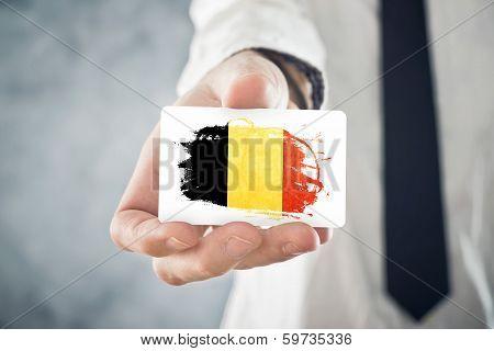 Belgian Businessman Holding Business Card With Belgium Flag