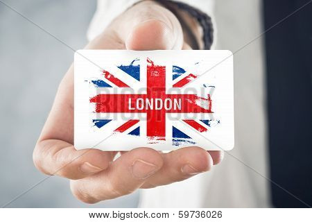 British Businessman Holding Business Card With Great Britain Flag