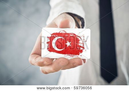 Turkish Businessman Holding Business Card With Turkey Flag