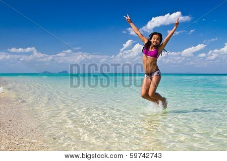 Girl Jumping In The Water At The Beach Of The Koh Ngai Island Thailand