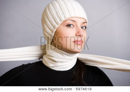 Beautiful Young Woman In White Scarf And Cap