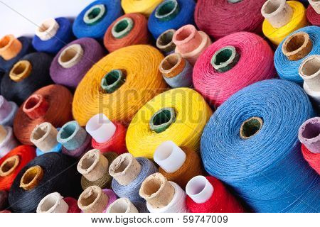 spools of thread of different size texture and colour