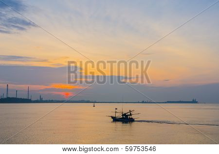 Large Oil Tanker And Small Fishing Boat