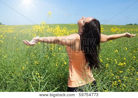 Beautiful woman at spring on a meadow