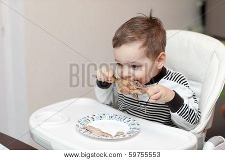 Boy Eating Duck Leg