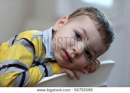 Portrait Of Kid At Highchair