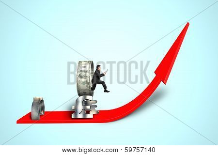 Businessman Jumping Through Money Circle On Growing Arrow