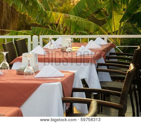 Tables At Outside Area Of Restaurant, Served For A Supper