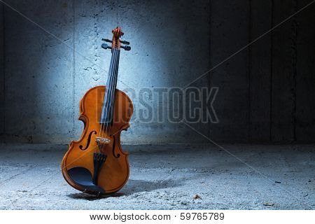 Violin on concrete wall background