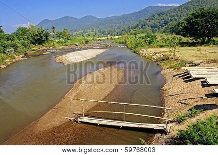 The Construction Of Bamboo Rafts On The River Bank