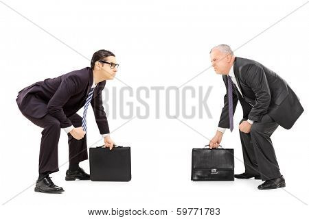 Two competitive businessmen standing in sumo wrestling stance isolated on white background