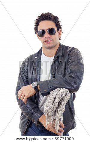 Man In A Leather Jacket Leaning On A Broom