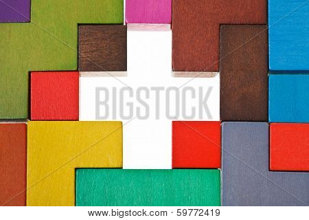 Above View Of Cross Shape Hole In Puzzle