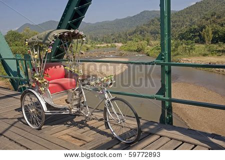 Tricycle On Old Bridge