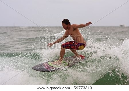 Young Male Surfs Wave Off Florida Coastline