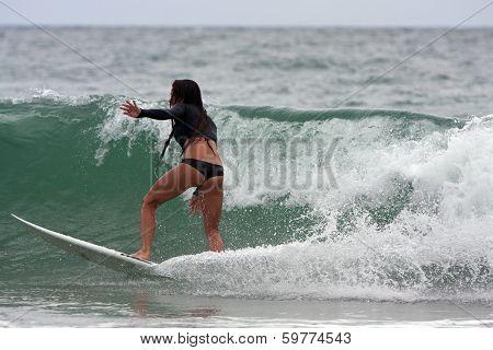 Female Surfer Cuts Across Wave Off Florida Coastline