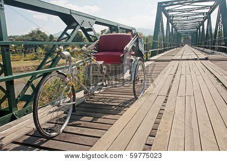 Tricycle On Old Bridge - Memorial Bridge In Pai