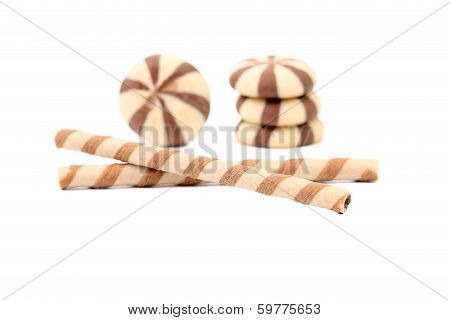 Chocolate striped wafer rolls and stake biscuits.