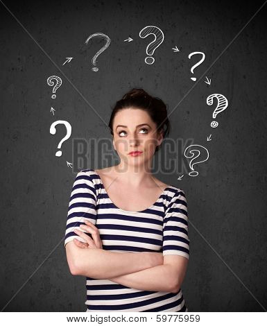 Thoughtful young woman with drawn question marks circulating around her head