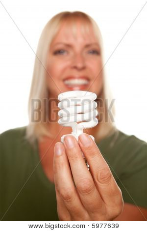 Attractive Blonde Woman Holds Energy Saving Light Bulb