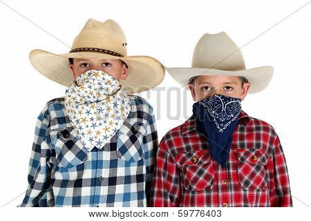 Two Cowboy Brothers Wearing Hats And Bandanas Looking At Camera Serious