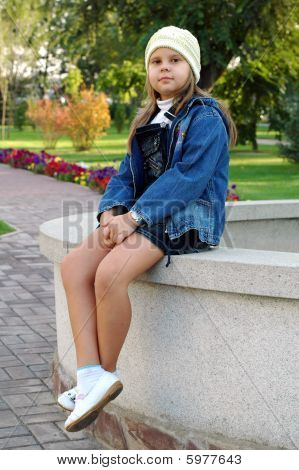 girl smiling on stone