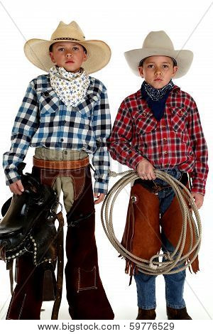 Cowboy Brothers Wearing Hats Holding Saddle And Rope