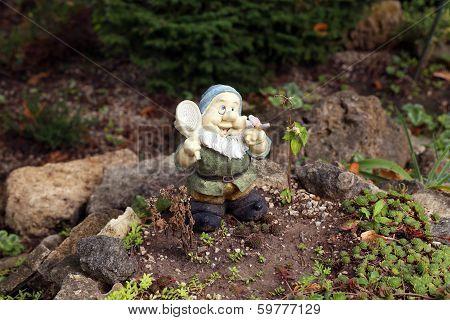 Close up of garden gnome.