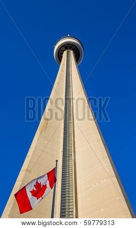 CN Tower From Ground Level With The Canadian Flag