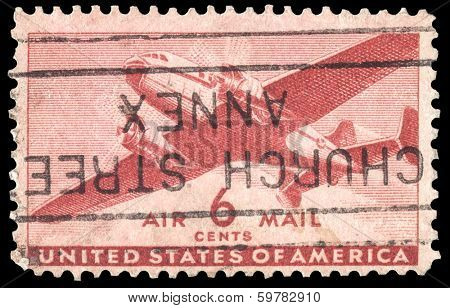USA-CIRCA 1941: A 6 cent United States Airmail postage stamp shows image of a twin-engined transport plane, circa 1941.