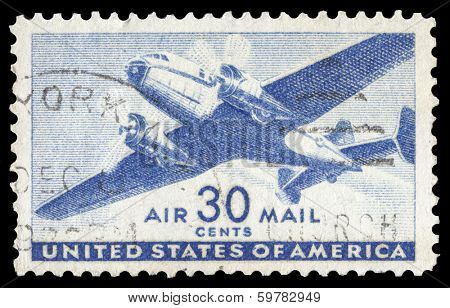 USA-CIRCA 1941: A 30 cent United States Airmail postage stamp shows image of a twin-engined transport plane, circa 1941.