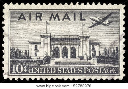 USA-CIRCA 1947: A 10 cent United States Airmail postage stamp, shows image a Martin 202 plane over Pan American Union Building, Washington DC, circa 1947